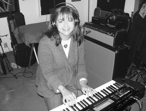 Suzanne in the studio recording Get a Gun