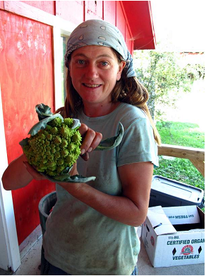 Tamara shows off the organic crops grown on the Valley Dream Farm.