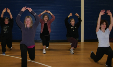 Johanne (far right) dancing her way to better health