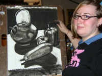 Sarah Holl's intern Amy Hufnagle with charcoal drawing