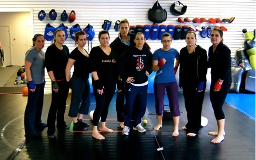"""The Dungeon Ladies"" with 2012 Olympic hopeful Alex Love  (center, front) and instructor Deanne Tolley (center, rear)"