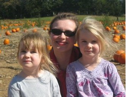 Apple picking with her daughters
