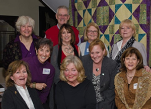 Past and present Board of Directors with the WE CAN 10th anniversary Quilt
