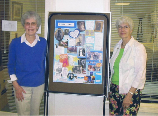 "Barbara Nagle (right) and the daughter of a Beacon Hospice patient display a  ""Chart-A-Life"" poster.  Photo is courtesy of Beacon Hospice, Inc."